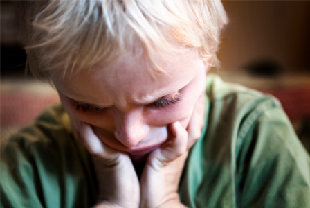 Boy with autism crying