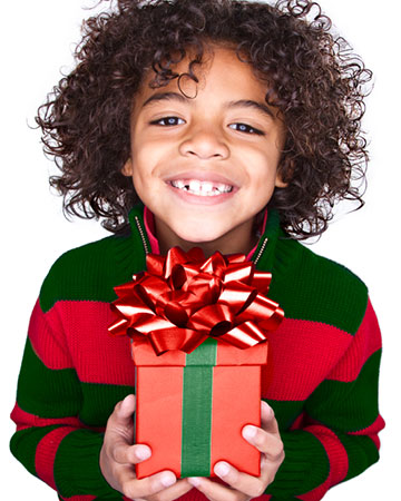 Young child happy about Christmas gift | Sheknows.ca