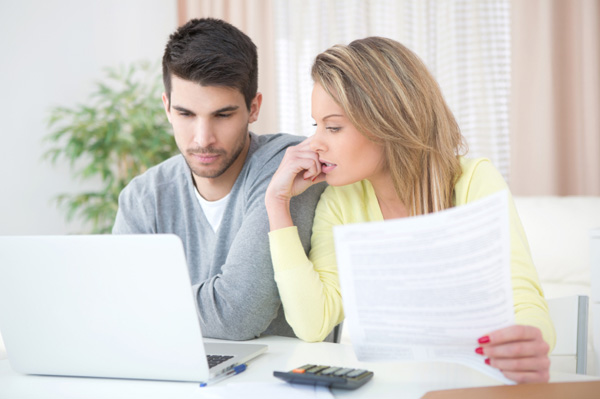 Young couple going over finances