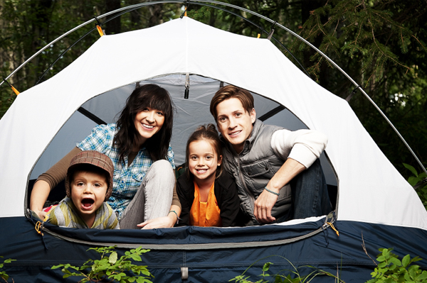 young family out camping