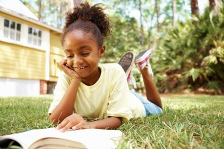 young girl reading novel