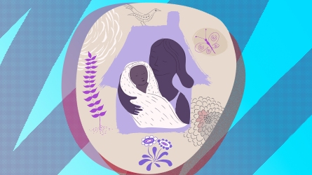 Woman holding baby in silhouette of