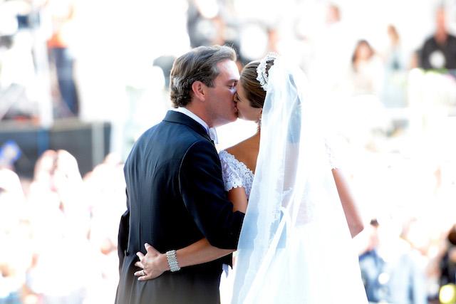 Princess Madeleine of Sweden & Christopher O'Neill kiss on their wedding day