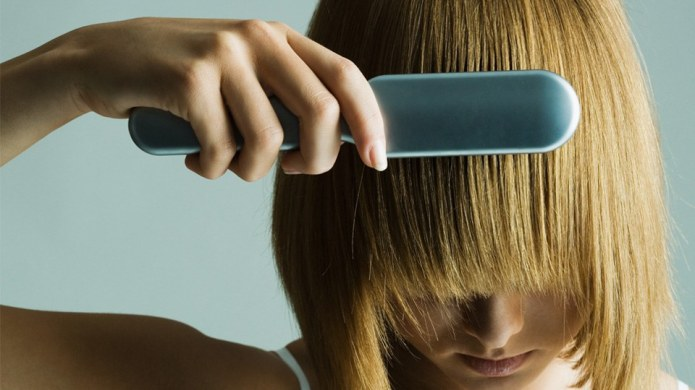 This futuristic hairbrush literally fixes your
