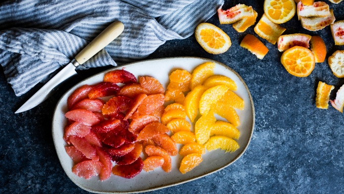 Various citrus fruits on a plate,