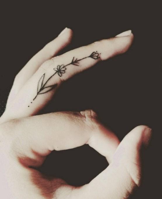 Chic Finger Tattoo Inspo: Flowers