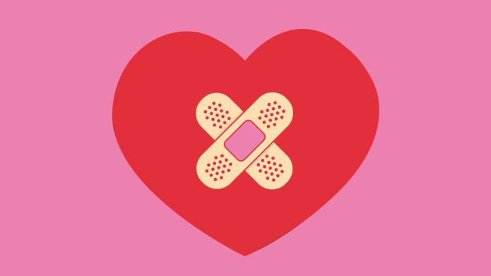 Red heart with two bandages in