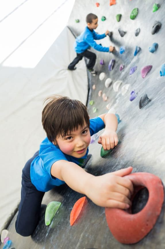 Child Rock Climbing in Indoor Gym