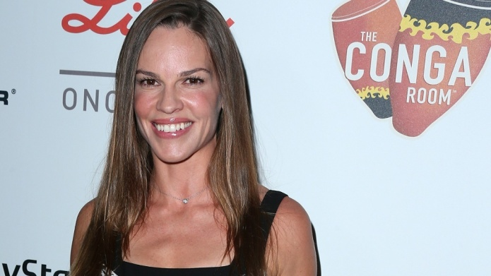 Hilary Swank spotted getting cozy with