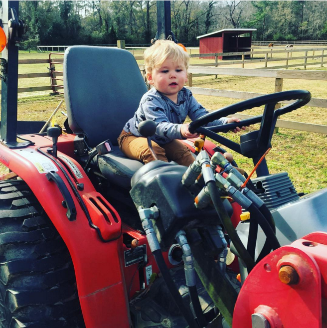 Jenelle Evans son Kaiser riding a tractor