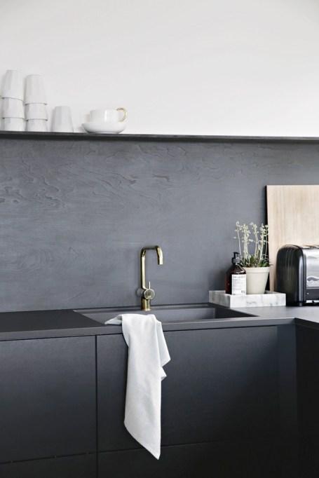 Black painted plywood backsplash