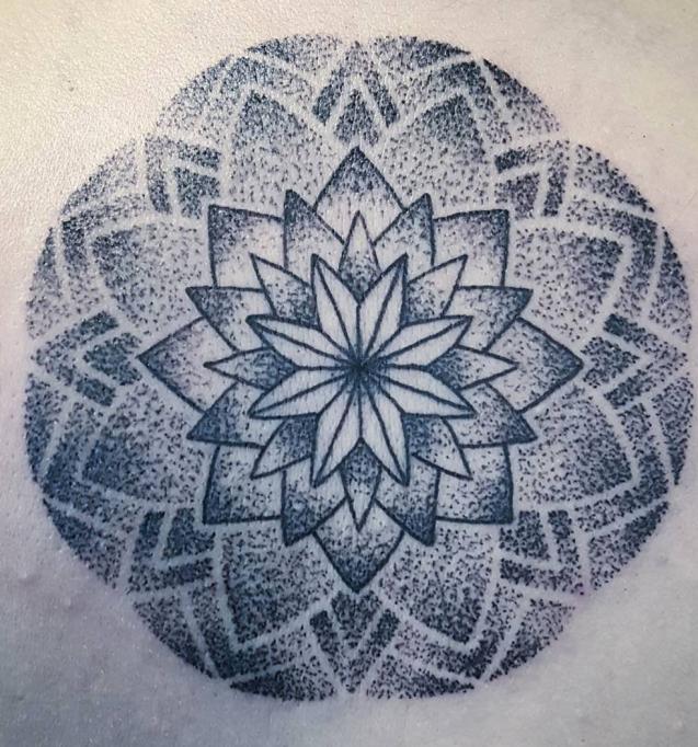 Flower pointillism tattoo