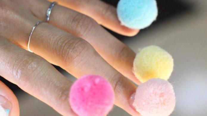 Women are sticking pom-poms on their