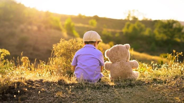 Boy and his teddy bear friend