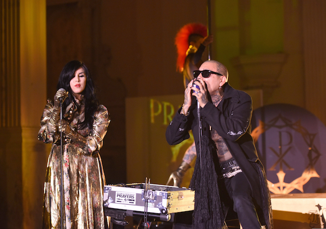Kat Von D and Leafar Seyer perform together on stage at Kat Von D Beauty 10th Anniversary Party at Vibiana Cathedral