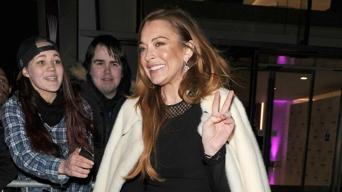Lindsay Lohan is trying so hard