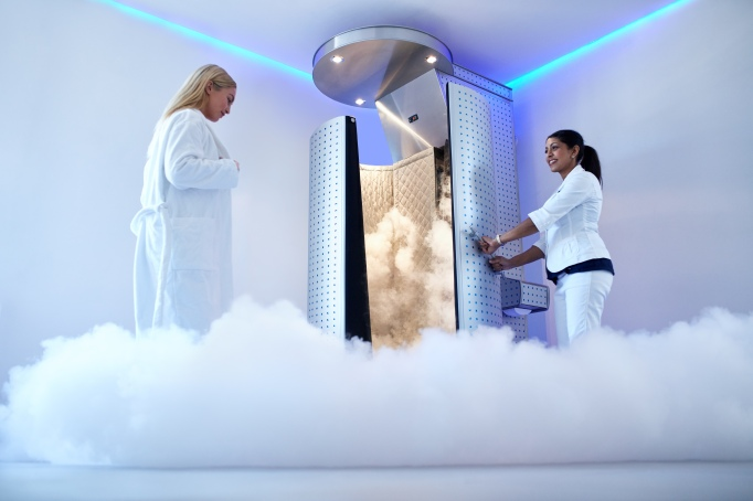 Woman entering cryotherapy chamber