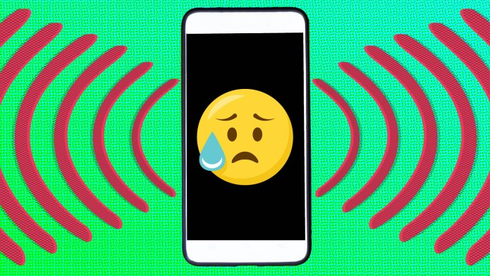 Crying emoji on a cell phone