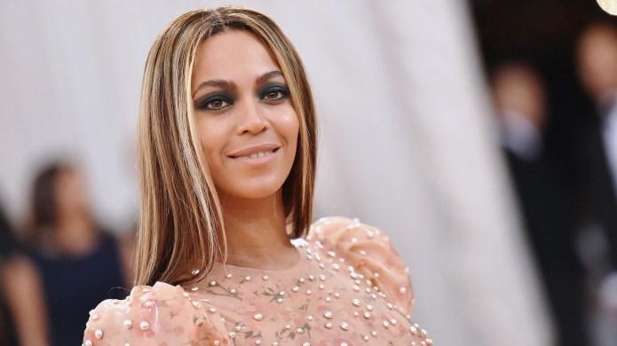 Beyonce in fancy dress smiling