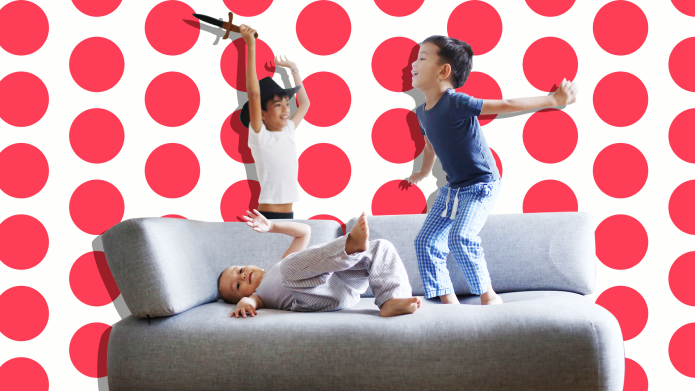 Three kids jumping on a couch