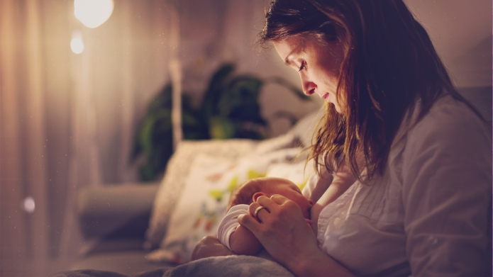 breastfeeding mother at home