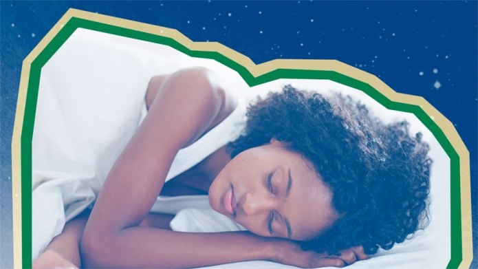 Woman sleeping on white sheets against