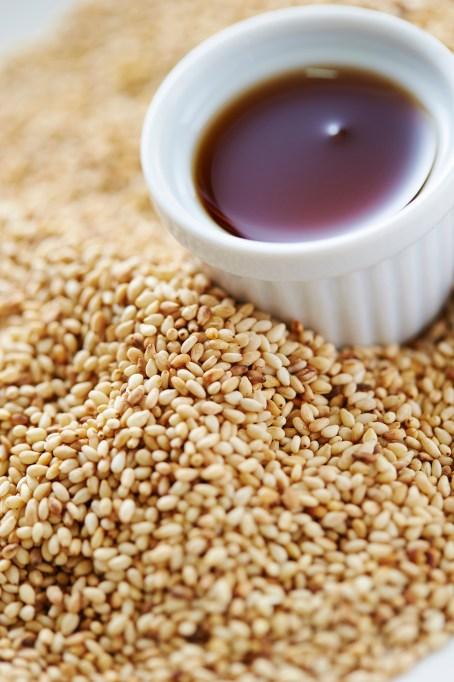 Sesame oil next to sesame seeds