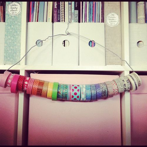 An old wire hanger can be used to store washi tape.