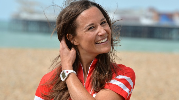 Pippa Middleton smiling and holding her