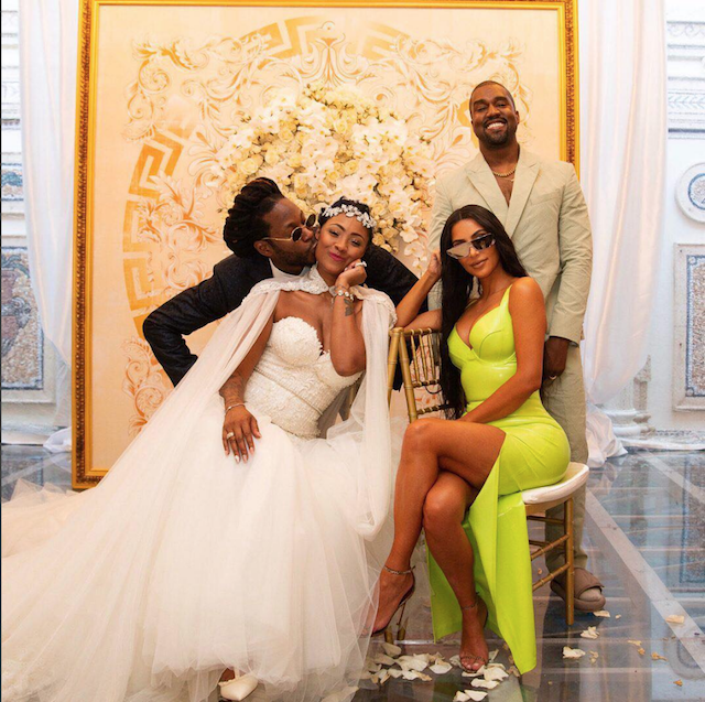 2 Chainz and Kesha Ward pose for a photo for Vogue with Kanye West and Kim Kardashian West