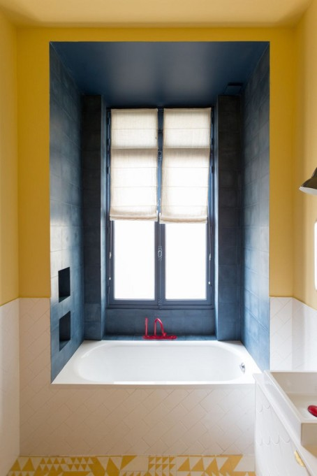 Vibrant blue and yellow colored bathroom