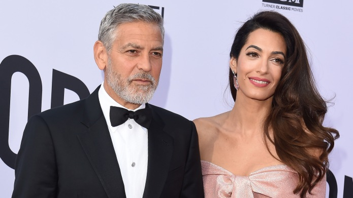 George Clooney and Amal Clooney arrive