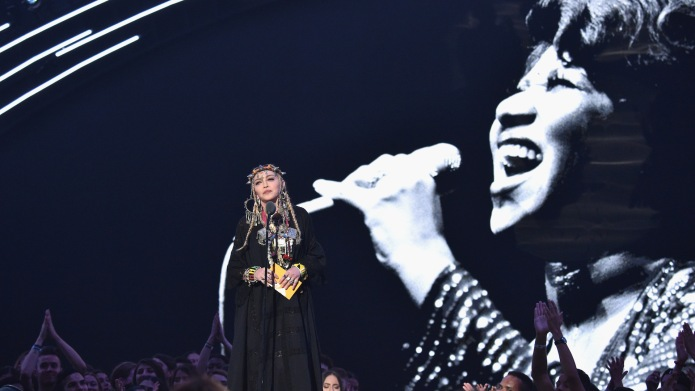 Madonna presents onstage during 2018 MTV