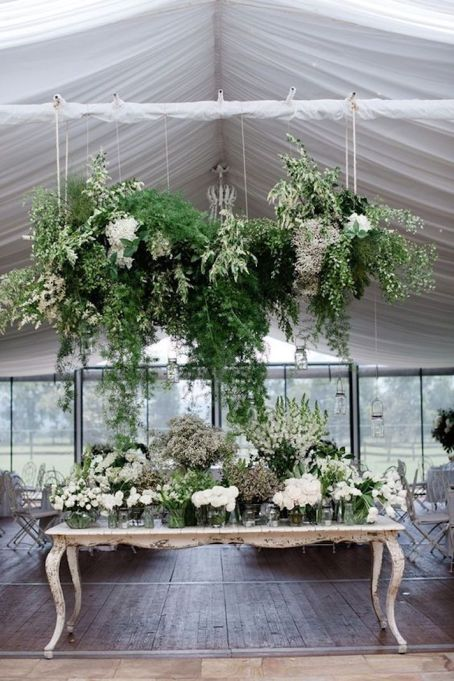 Suspended flowers for a gift table