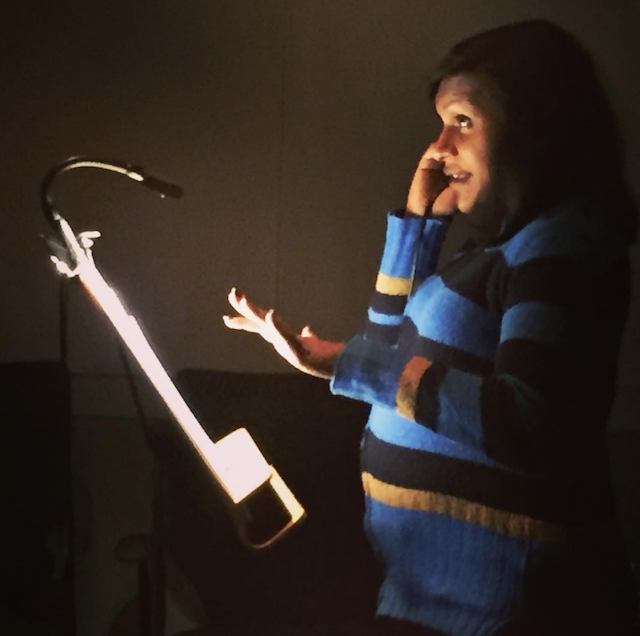 Mindy Kaling in a voice over booth while she is pregnant