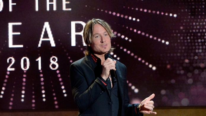 Keith Urban speaks onstage during the
