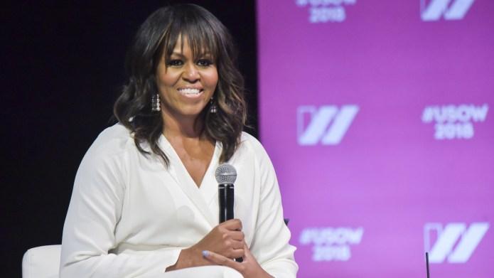 Michelle Obama speaks on stage at