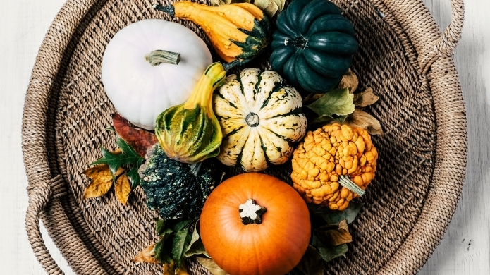 Variety of pumpkins on a wicker