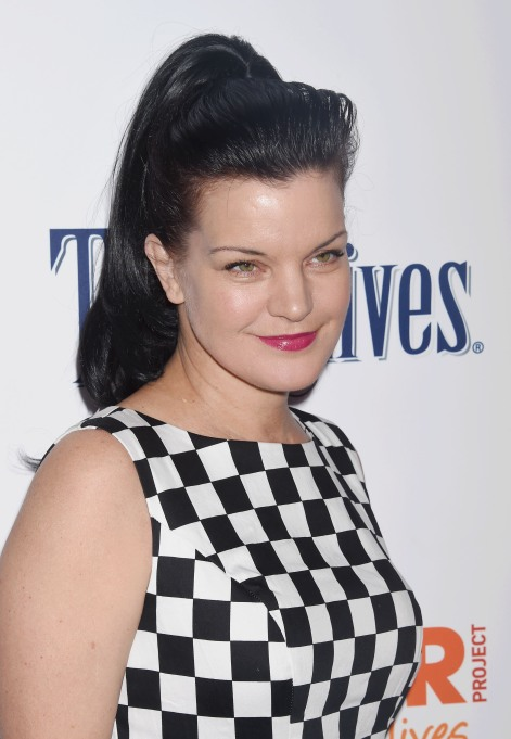 Pauly Perrette in black and white checked dress