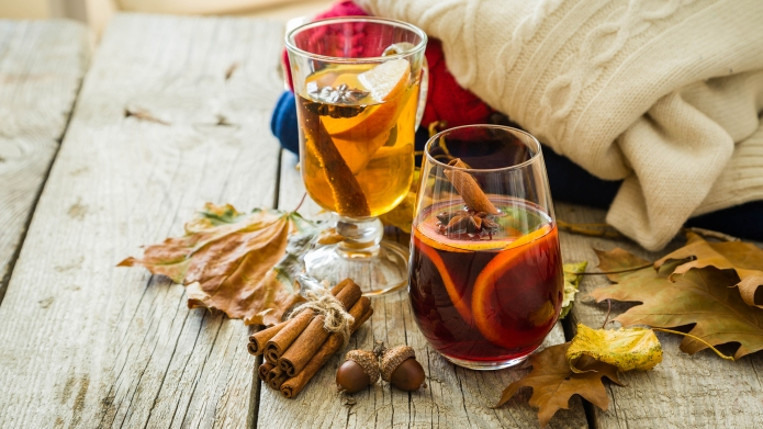 Selection of autumn drinks on wood