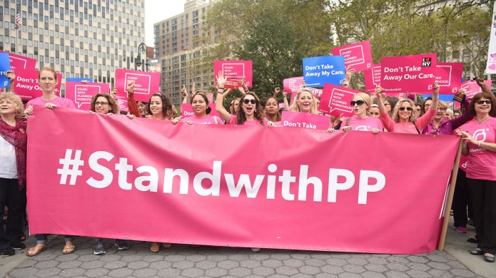 People marching with a Planned Parenthood