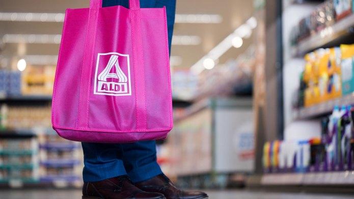 Shopper with Aldi grocery bag