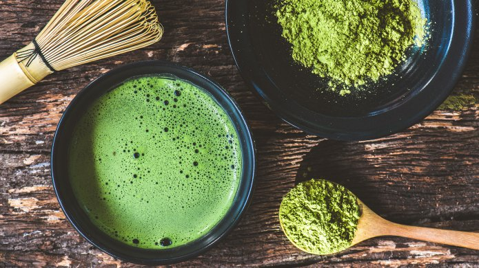 Matcha drink and powder from above.