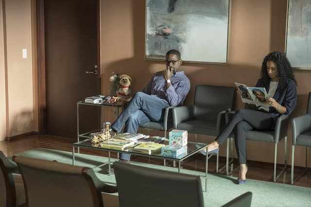 Randall (Sterling K. Brown) and Beth (Susan Kelechi Watson) sit in a waiting room surrounded by children's toys.