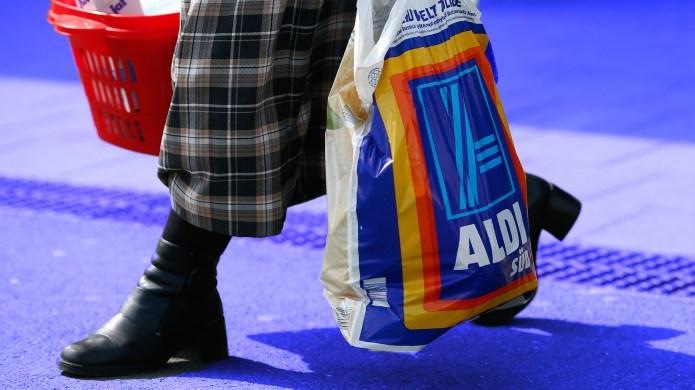 Woman carrying Aldi bag