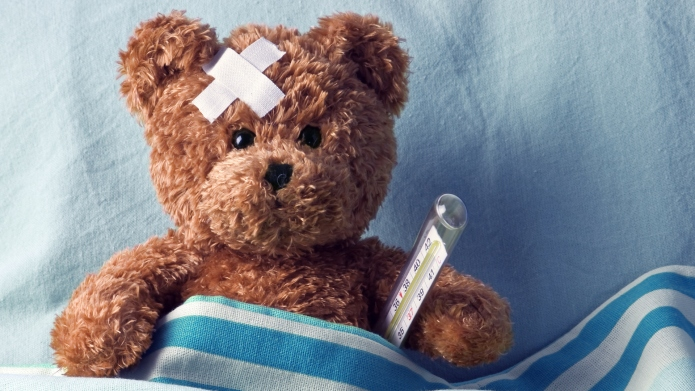 photo of teddy bear with bandages