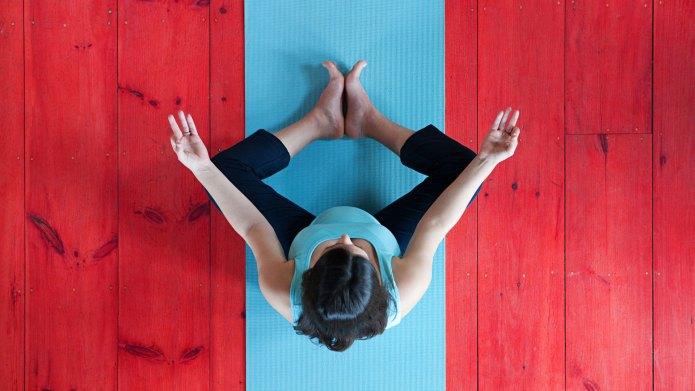 Pregnant woman on yoga mat