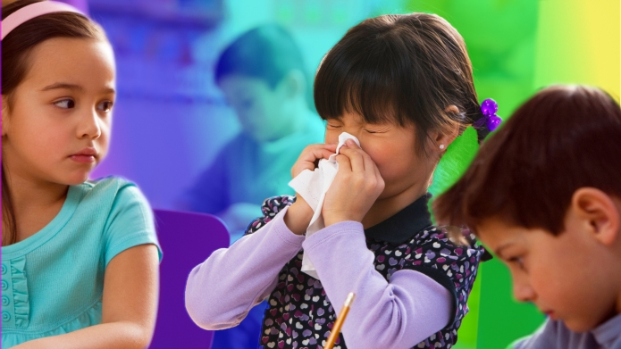 Girl blowing nose surrounded by two