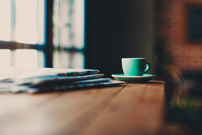 Newspaper and coffee cup