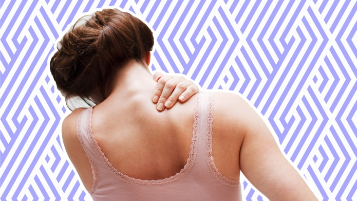 Woman from behind clutching her shoulder
